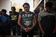 Yolanda Montenegro, 25, Honduran, attends a meeting and prays with other migrants within the Casa del Migrante Amar in charge of Pastor Aaron Casimiro, on June 27th, 2014 in Nuevo Laredo, Tamaulipas, Mexico. CREDIT: Rodrigo Cruz for The New York Times