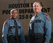 Retiring Houston ISD Chief of Police Jimmy Dotson, left, and incoming Chief Robert Mock, right, pose for a photograph at the headquarters building, December 18, 2013.