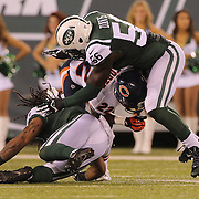 Matt Forte, Chicago Bears, is tackled by Demario Davis, New York Jets, during the New York Jets Vs Chicago Bears, NFL regular season game at MetLife Stadium, East Rutherford, NJ, USA. 22nd September 2014. Photo Tim Clayton for the New York Times