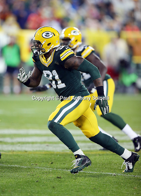 Green Bay Packers linebacker Jay Elliott (91) chases the action during the 2015 NFL week 3 regular season football game against the Kansas City Chiefs on Monday, Sept. 28, 2015 in Green Bay, Wis. The Packers won the game 38-28. (©Paul Anthony Spinelli)