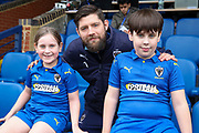 AFC Wimbledon midfielder Anthony Wordsworth (40) with AFC Wimbledon Mascots during the EFL Sky Bet League 1 match between AFC Wimbledon and Blackpool at the Cherry Red Records Stadium, Kingston, England on 22 February 2020.