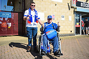 An Oldham fan in his wheelchair gives a thumbs up during the EFL Sky Bet League 1 match between Northampton Town and Oldham Athletic at Sixfields Stadium, Northampton, England on 5 May 2018. Picture by Dennis Goodwin.