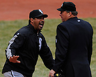 Ozzie Guillen argues with home plate umpire Gerry Davis in the eighth inning Monday, March 31 at Progressive Field in Cleveland. The Indians defeated the White Sox 10-8.