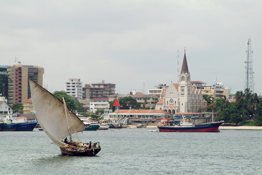 Africa. Tanzania. Dar es Salaam. .City view. contrast of old fashioned dhow and modern hi rise buildings..CD0010