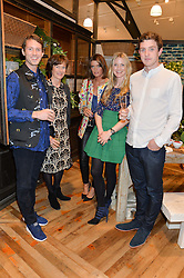 Left to right, NED CORBETT-WINDER, KATE CORBETT-WINDER, SARAH CORBETT-WINDER, WILLOW CROSSLEY and TOM CORBETT-WINDER at a party to celebrate the publication of 'Inspire: The Art of Living With Nature' by Willow Crossley held at Anthropologie, 131-141 Kings Road, London on 13th March 2014.