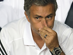 Real Madrid coach Jose Mourinho pulls his nose before the game.  Barcelona v Real Madrid, Supercopa first leg, Camp Nou, Barcelona, 23rd August 2012...Credit - Eoin Mundow/Cleva Media.