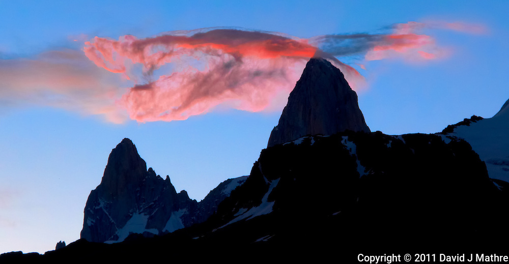 Silhouette of Mount Fitz Roy in Patagonia at Dusk with Glowing Orange Clouds from Hosteria El Pilar in El Chalten, Argentina. Image taken with a Leica D-Lux 5 camera (ISO 80, 19.2 mm, f/5.6, 1100/sec)