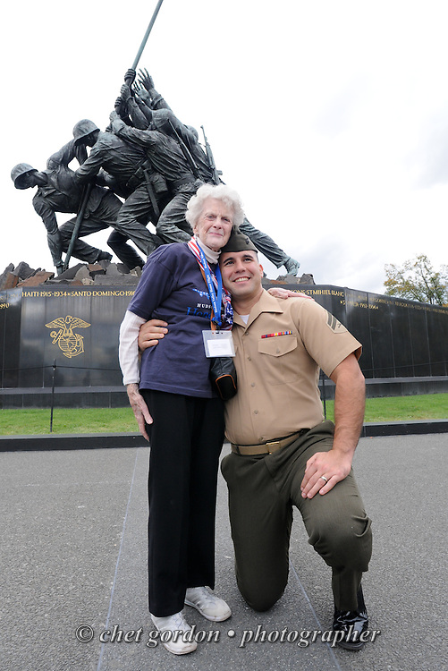 A WWII Veteran Marine and an active duty Marine Corporal pose in front of the Marine Corps War Memorial in Arlington, VA on Saturday, October 18, 2014. Seventy-five veterans from the Westchester County (NY) area toured the WWII Memorial and Arlington National Cemetery on the inaugural flight from Westchester County Airport in White Plains, NY. Hudson Valley Honor Flight is a chapter of the Honor Flight Network, which provides free flights for WWII Veterans and tours of the WWII Memorial constructed in their honor, and other sites in the nation's capital.  © www.chetgordon.com