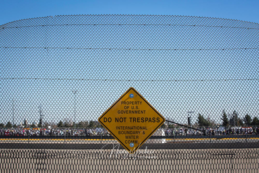 The crowd attending Mass with Pope Francis in Ciudad Juarez can be seen from a U.S. border fence in El Paso, Texas, Feb. 17. Pope Francis celebrated the final Mass of his Mexico visit in Juarez. (CNS photo/Nancy Wiechec)