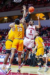 NORMAL, IL - February 15: Keith Fisher III one hands a shot while double teamed during a college basketball game between the ISU Redbirds and the Valparaiso Crusaders on February 15 2020 at Redbird Arena in Normal, IL. (Photo by Alan Look)