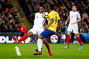 England Liverpool defender Joe Gomez (4) stops Brazil Manchester City forward Gabriel Jesus (9)  during the International Friendly match between England and Brazil at Wembley Stadium, London, England on 14 November 2017. Photo by Simon Davies.