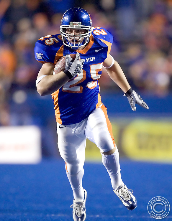 01 November 2006: Boise State linebacker Kory Hall returns an interception for a touchdown against rival Fresno State during the second half of the Nationally televised ESPN game in Bronco Stadium  in Boise Idaho.
