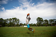 Xavier Mascareñas/Treasure Coast Newspapers; Fort Pierce Westwood receiver Cameron Webb catches a pass during a drill on the first day of football practice Monday, July 30, 2018, at Fort Pierce Westwood High School.