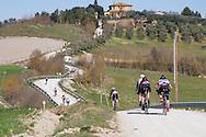 Strade Bianche Women Elite racers on the gravel section of strada di Presciano.