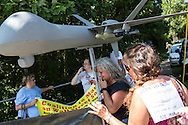 Activists at the March on Wall Street South protest carry a model of a predator drone on Sunday, September 2, 2012 in Charlotte, NC.