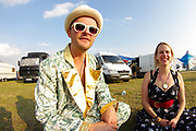 Wedding guests attending festival wedding , Boomtown, Matterley Estate, Alresford Road, near Winchester, Hampshire, UK, August, 2010