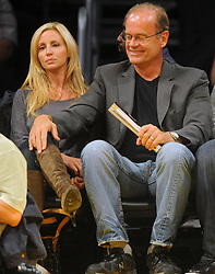 ©2009 GAMEPIKS 310-828-3445<br /> <br /> Kelsey Grammer and his wife Camille sit courtside as they attend the Los Angeles Lakers/Dallas Mavericks NBA game at Staples Center in Los Angeles on October 30, 2009. The Mavericks defeated the Lakers 94-80.<br /> <br /> XYZ (Mega Agency TagID: MEGAR63945_11.jpg) [Photo via Mega Agency]