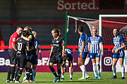 Lee Collins (Referee) talking with Ji So-Yun (Chelsea) with Magdalena Eriksson (Capt)(Chelsea) holding her with Guro Reiten (Chelsea) looking on during the FA Women's Super League match between Brighton and Hove Albion Women and Chelsea at The People's Pension Stadium, Crawley, England on 15 September 2019.