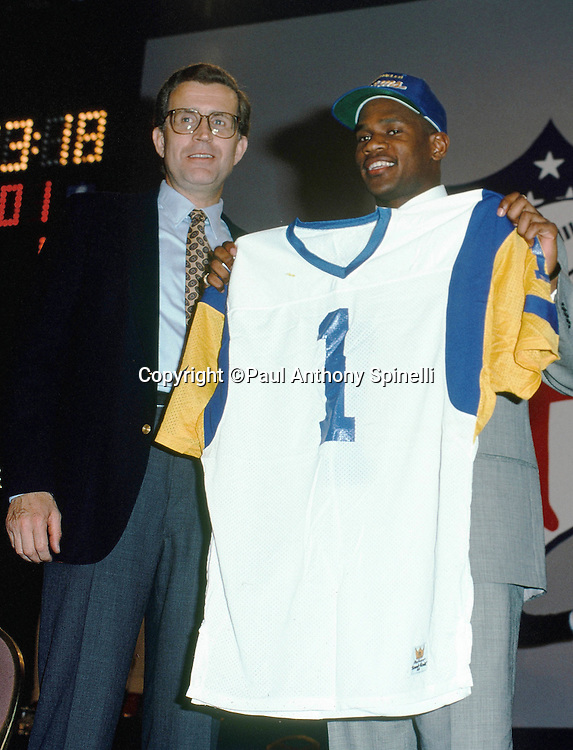 (L-R) NFL Commissioner Paul Tagliabue and Los Angeles Rams defensive back Todd Lyght, the Rams number one pick, hold up a jersey as they pose for a photo during the 1991 NFL Draft on April 21, 1991 in New York. (©Paul Anthony Spinelli)