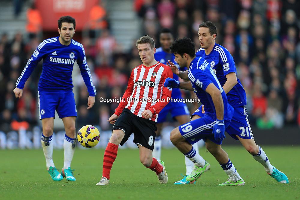 28th December 2014 - Barclays Premier League - Southampton v Chelsea - Steven Davis of Southampton battles with Chelsea players Nemanja Matic (R), Diego Costa (2R) and Cesc Fabregas (L) - Photo: Simon Stacpoole / Offside.