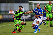 Forest Green Rovers defender Dominic Bernard (3) tussles with Oldham Athletic's Johan Branger-Engone (07) during the EFL Sky Bet League 2 match between Forest Green Rovers and Oldham Athletic at the New Lawn, Forest Green, United Kingdom on 3 August 2019.