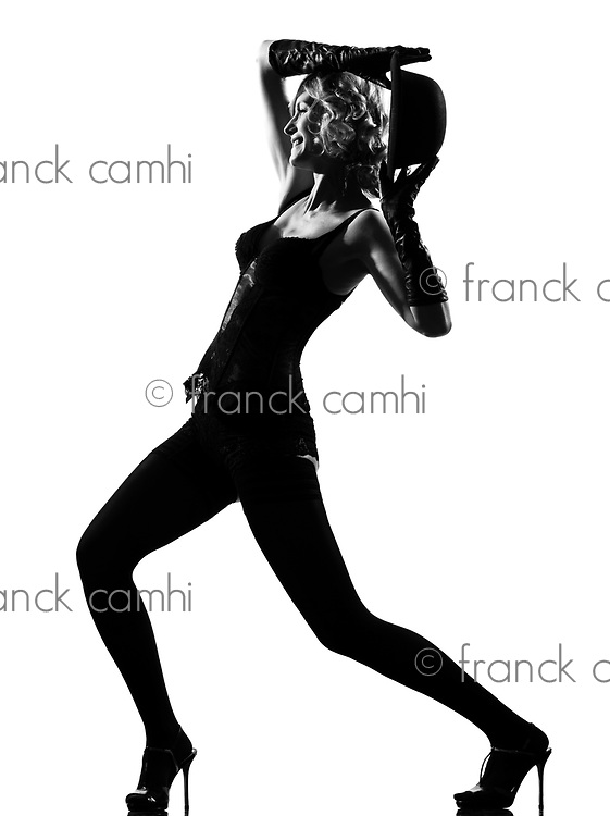 stylish silhouette caucasian beautiful woman dancing cabaret sexy  attitude behavior clothes full length on studio isolated white background