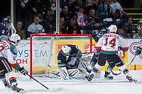 KELOWNA, CANADA - APRIL 3: Rourke Chartier #14 of the Kelowna Rockets scores a goal on Taran Kozun #35 of the Seattle Thunderbirds on April 3, 2014 during Game 1 of the second round of WHL Playoffs at Prospera Place in Kelowna, British Columbia, Canada.   (Photo by Marissa Baecker/Getty Images)  *** Local Caption *** Rourke Chartier; Taran Kozun;
