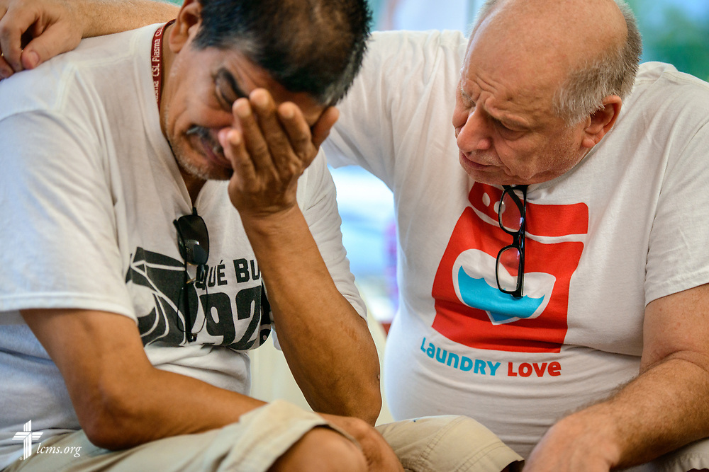"Roberto Cantu cries as Tom Kusiak, a retired physician and volunteer from St. Paul Lutheran Church, San Antonio, Texas, prays and counsels him during the Laundry Love ministry event on Wednesday, Aug. 2, 2017, at the E-Z Wash laundromat in San Antonio. Cantu's mother had died several days prior. ""They care for me here,"" he said. The monthly ministry event is supported by a grant through the ""Stand With Your Community"" program, which was made possible by a partnership between the LCMS, Thrivent Financial and Lutheran Church Extension Fund. LCMS Communications/Erik M. Lunsford"