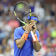 2016 U.S. Open - Day 7  Rafael Nadal of Spain reacts after missing a shot at the net at 6-6 in the fifth set tie break during his loss against Lucas Pouille of France in the Men's Singles round four match on Arthur Ashe Stadium on day six of the 2016 US Open Tennis Tournament at the USTA Billie Jean King National Tennis Center on September 4, 2016 in Flushing, Queens, New York City.  (Photo by Tim Clayton/Corbis via Getty Images)