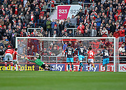 Bristol City forward Lee Tomlin (9) makes it 3-0 from the penalty spot during the Sky Bet Championship match between Bristol City and Sheffield Wednesday at Ashton Gate, Bristol, England on 9 April 2016. Photo by Adam Rivers.