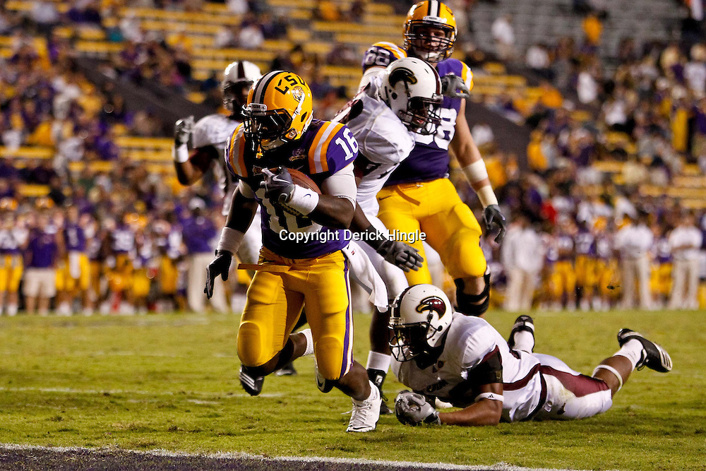 November 13, 2010; Baton Rouge, LA, USA; LSU Tigers running back Spencer Ware (16) runs for a touchdown during the second half against the Louisiana Monroe Warhawks at Tiger Stadium. LSU defeated Louisiana-Monroe 51-0.  Mandatory Credit: Derick E. Hingle