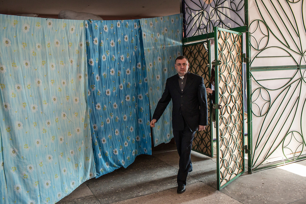 MARIINKA, UKRAINE - FEBRUARY 20, 2016:  Pastor Sergei Kosyak at the Christian Help Center of the Church of the Transfiguration in Mariinka, Ukraine. The Donetsk suburb has been the scene of some of the heaviest fighting recently between Ukrainian forces and pro-Russian rebels. CREDIT: Brendan Hoffman for The New York Times