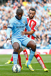 Yaya Toure of Manchester City is challenged - Photo mandatory by-line: Rogan Thomson/JMP - 07966 386802 - 30/08/2014 - SPORT - FOOTBALL - Manchester, England - Etihad Stadium - Manchester City v Stoke City - Barclays Premier League.