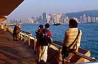 People view the Hong Kong skyline from the Promenade in Kowloon, Hong Kong, China.