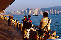 People view the Hong Kong skyline from the Promenade in Kowloon, Hong Kong, China.