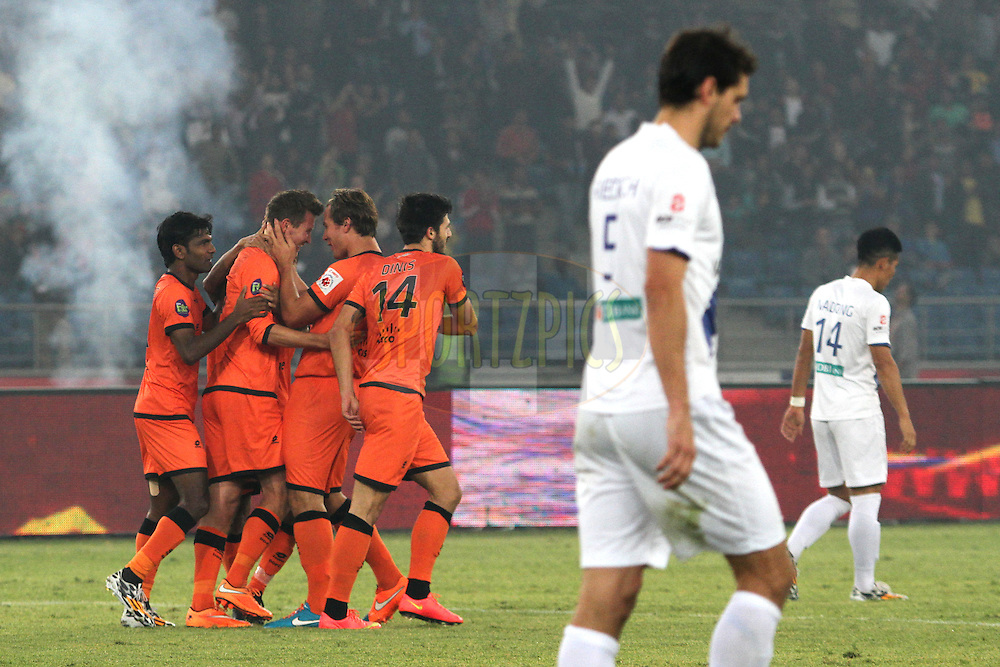 Mads Junker of Delhi Dynamos FC celebrates his goal with team players during match 43 of the Hero Indian Super League between The Delhi Dynamos FC<br /> and Mumbai City FC held at the Jawaharlal Nehru Stadium, Delhi, India on the 28th November 2014.<br /> <br /> Photo by:  Deepak malik / ISL/ SPORTZPICS