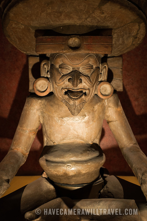 MEXICO CITY, MEXICO--A statue of Huehuetéotl, the Aztec God of Fire, at the National Museum of Anthropology. The National Museum of Anthropology showcases  significant archaeological and anthropological artifacts from the Mexico's pre-Columbian heritage, including its Aztec and indiginous cultures.