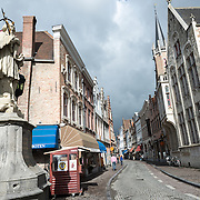 Wollestraat, one of the main streets radiating of the Markt in the historic center of Bruges, Belgium.