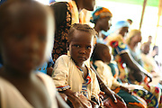 A young refugee girl from Chad sits on her mother's lap at the health center of the  Langui refugee camp outside the town of Garoua, Cameroon on Thursday September 17, 2009.