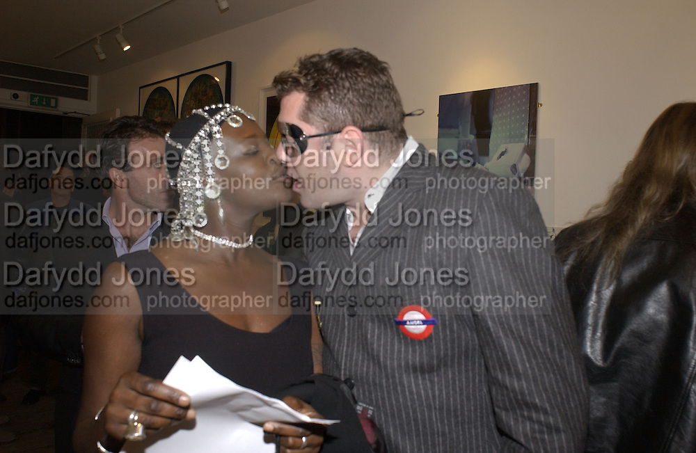 Millie Laws and John Beasley. 2001 A Space Oddity. Colony Room exhibition.  A22 Gallery. 28 October 2001. © Copyright Photograph by Dafydd Jones 66 Stockwell Park Rd. London SW9 0DA Tel 020 7733 0108 www.dafjones.com