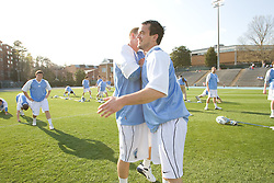 22 March 2008: North Carolina Tar Heels midfielder Sean Delaney (34) and midfielder Bobby McAuley (43) fake an embrace for me after I missed the first embrace before playing the Maryland Terrapins at Fetzer Field in Chapel Hill, NC.