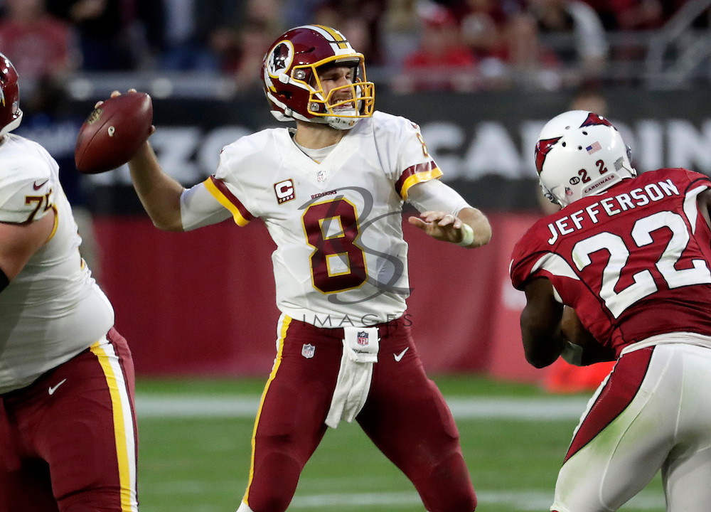 Washington Redskins quarterback Kirk Cousins (8) throws against the Arizona Cardinals during the second half of an NFL football game, Sunday, Dec. 4, 2016, in Glendale, Ariz. (AP Photo/Rick Scuteri)