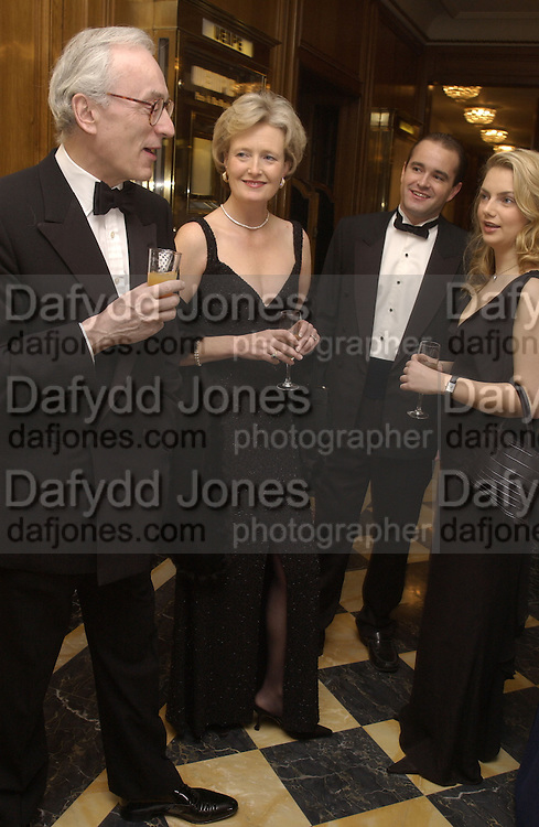 Lord and Lady Chadlington, Olly Spry and  Sybilla Rufus-Isaacs. Crillon Debutantes Ball 2002. Paris. 7 December 2002. © Copyright Photograph by Dafydd Jones 66 Stockwell Park Rd. London SW9 0DA Tel 020 7733 0108 www.dafjones.com