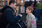 Local novelist Stella Duffy is interviewed while supporting the protest outside Carnegie Library in Herne Hill, south London while occupiers remain inside the premises on day 5 of its occupation, 4th April 2016. Duffy is a nearby resident and a passionate advocate for public libraries serving the underprivilaged. The angry local community in the south London borough have occupied their important resource for learning and social hub for the weekend. After a long campaign by locals, Lambeth have gone ahead and closed the library's doors for the last time because they say, cuts to their budget mean millions must be saved. A gym will replace the working library and while some of the 20,000 books on shelves will remain, no librarians will be present to administer it.