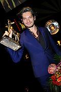NFF - Nederlands Filmfestival - uitreiking van de Gouden Kalveren in Tivolli Utrecht.<br /> <br /> op de foto:  Maarten Heijmans met een Gouden Kalf voor Beste Acteur Televisiedrama voor zijn rol in Ramses