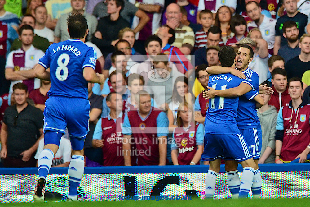 Picture by Ian Wadkins/Focus Images Ltd +44 7877 568959<br /> 21/08/2013<br /> Eden Hazard of Chelsea is congratulated by Oscar of Chelsea after opening the scoting during the Barclays Premier League match at Stamford Bridge, London.