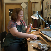 Kate Harrington uses a hand plan to fine tunr the pipes for an organ being bult by C.B. Fisk, Gloucester, MA