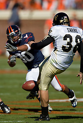 Virginia safety Nate Lyles (30) comes close to blocking a punt from Wake Forest kicker Sam Swank (38).  The #23 Virginia Cavaliers defeated the #24 Wake Forest Demon Deacons 17-16 at Scott Stadium in Charlottesville, VA on November 3, 2007.