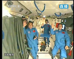 59870559  <br /> This TV grab taken on June 20, 2013 shows the three crew members of Shenzhou-10 spacecraft waving at the end of a lecture to students on Earth, aboard China s space module Tiangong-1. A special lecture began Thursday morning, given by Wang Yaping aboard China s space module Tiangong-1 to students on Earth, Thursday June 20, 2013.<br /> UK ONLY
