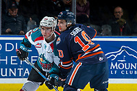 KELOWNA, CANADA - FEBRUARY 24: Liam Kindree #26 of the Kelowna Rockets faces off against Justin Sigrist #10 of the Kamloops Blazers during second period on February 24, 2018 at Prospera Place in Kelowna, British Columbia, Canada.  (Photo by Marissa Baecker/Shoot the Breeze)  *** Local Caption ***